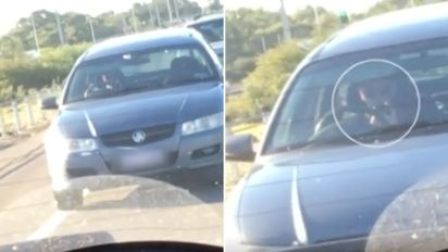 Video shows driver on phone swerving wildly