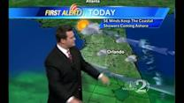 Rain Moves In, Stays Through the Work Week