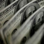Dollar holds near 10-week low ahead of inflation report