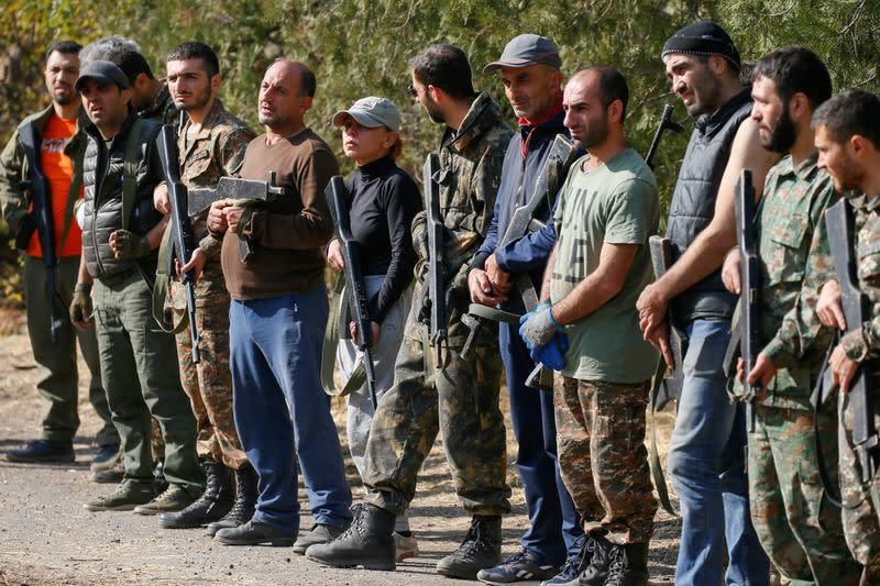 With ropes and wooden guns, returning Armenians train for war