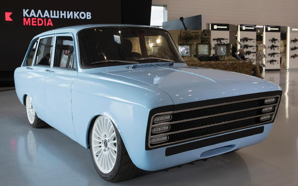 A handout picture taken on August 22, 2018 and released by Kalashnikov media press office, shows a retro-looking pale blue prototype electric car, the CV-1, produced by Russian arms maker Kalashnikov, in Moscow