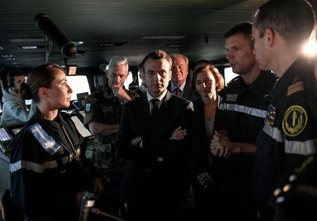 """French President Emmanuel Macron visits the aircraft carrier """"Charles de Gaulle"""" after its renovation, in Toulon"""