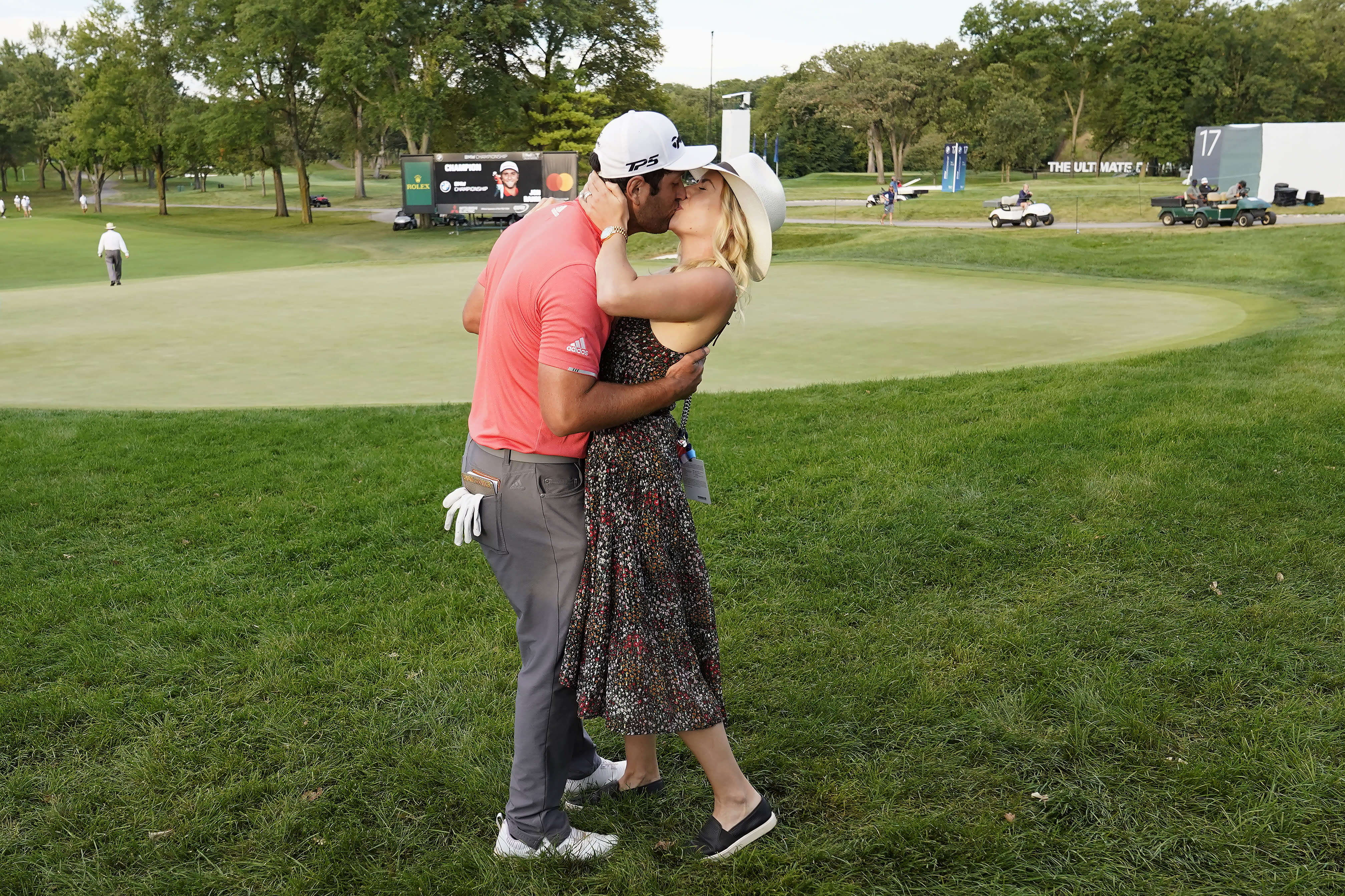 Jon Rahm, left, celebrates with his wife, Kelley Cahill, after winning the BMW Championship golf tournament at the Olympia Fields Country Club in Olympia Fields, Ill., Sunday, Aug. 30, 2020. (AP Photo/Charles Rex Arbogast)