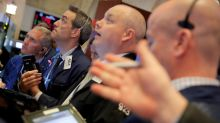 Oil tumbles, weighs on energy shares; bank stocks rise