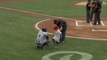 Young Reds fan gets angry with Dee Gordon, kicks him in the shin