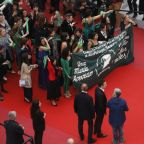 Clad in green, film crew protest Argentina abortion law on Cannes red carpet