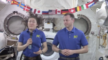 U.S. astronauts aboard ISS discuss private space race and trips to Mars