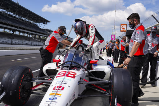 Marco Andretti climbs into his car during practice for the Indianapolis 500 auto race at Indianapolis Motor Speedway in Indianapolis, Friday, Aug. 14, 2020. (AP Photo/Michael Conroy)