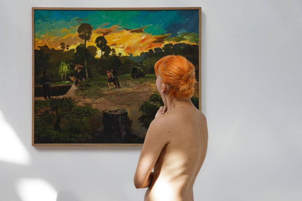 "The naturists snapped up special invites online to shed their inhibitions and strip back the meaning of art to its bare essentials at the Palais de Tokyo exhibition ""Discordia, Daughter of the Night,"" a compilation of paintings by seven contemporary artists (AFP Photo/GEOFFROY VAN DER HASSELT)"