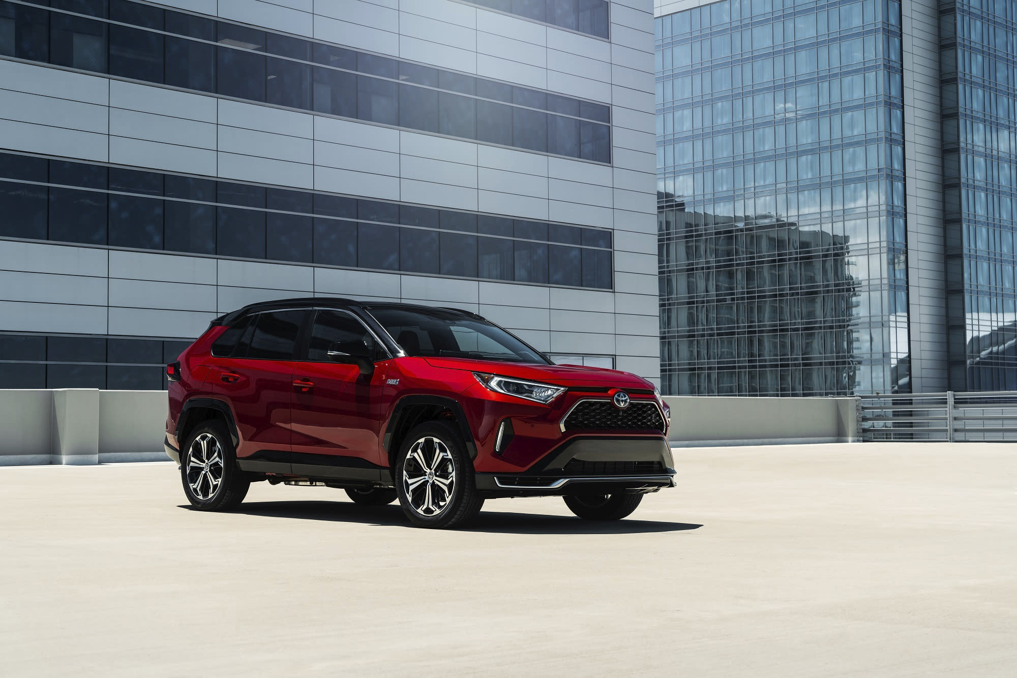 This photo provided by Toyota shows the RAV4 Prime, a plug-in hybrid crossover SUV with all-wheel drive and a battery pack. It offers an estimated 42 miles of electric-only range, among the best in the class. (Courtesy of Toyota Motor Sales U.S.A. via AP)