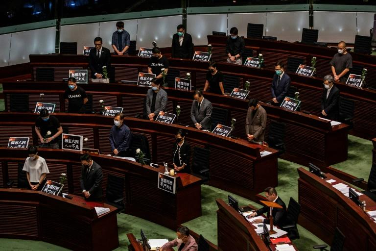 Pro-democracy legislators are a minority in the partially elected legislature and often hold protests (AFP Photo/ISAAC LAWRENCE)
