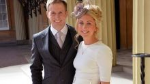 Pregnant cycling hero Laura Kenny and husband Jason beam with pride as they receive their CBEs at Buckingham Palace