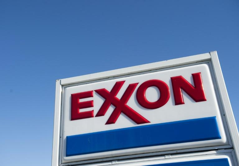Exxon Mobil and Chevron reported losses in the second quarter, as the weakened industry outlook amid the coronavirus crisis hammers petroleum companies (AFP Photo/Saul LOEB)
