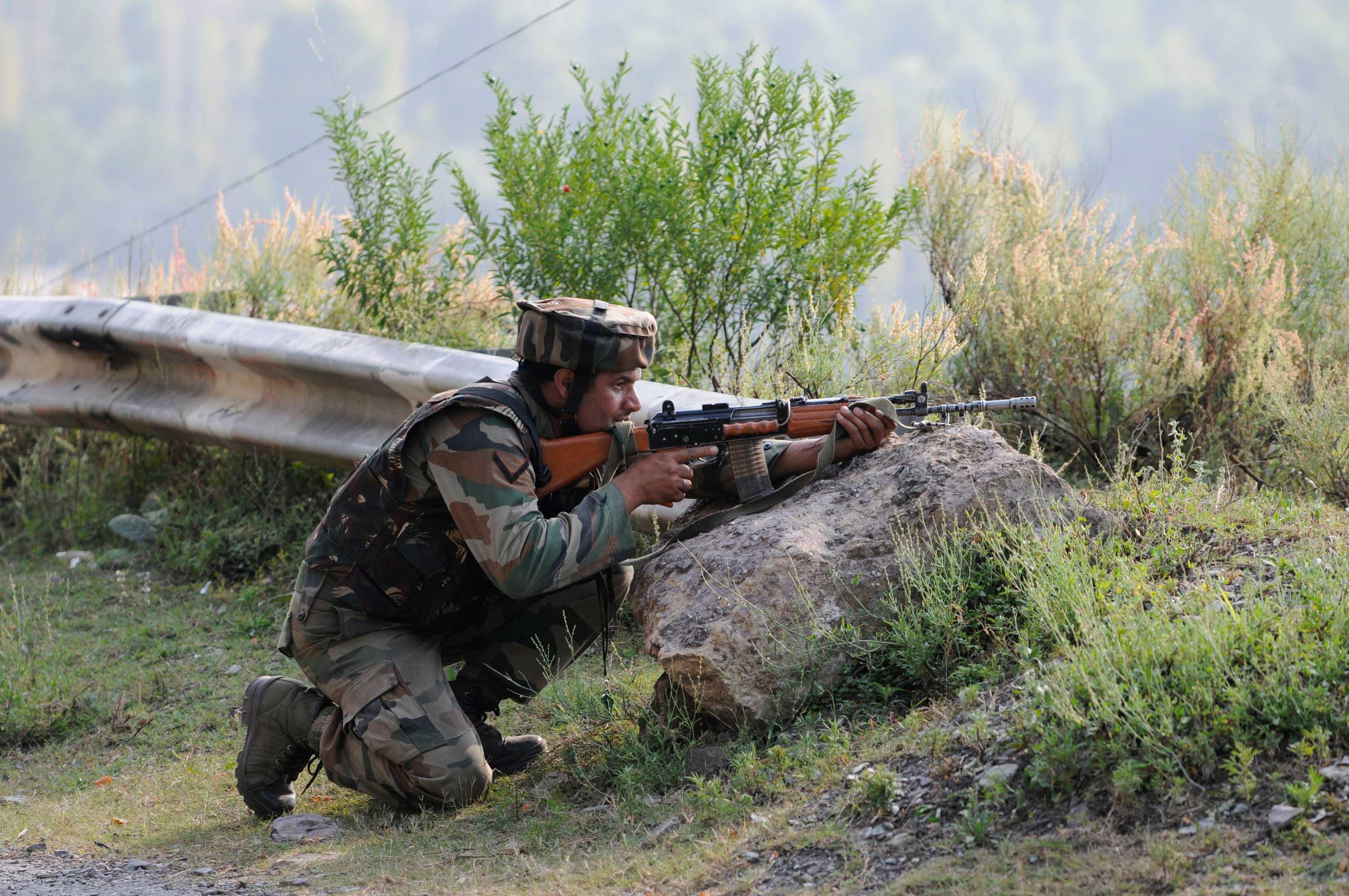 <p>An army soldier at the army base which was attacked by militants in the town of Uri, west of Srinagar. Photo – Getty </p>