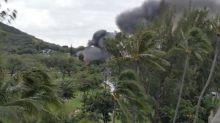 Gunman kills two Hawaii police officers, dies in house fire: local media