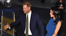 Meghan Markle's ditches messy bun for perfect curls, but it's her ruffled dress that causes a stir