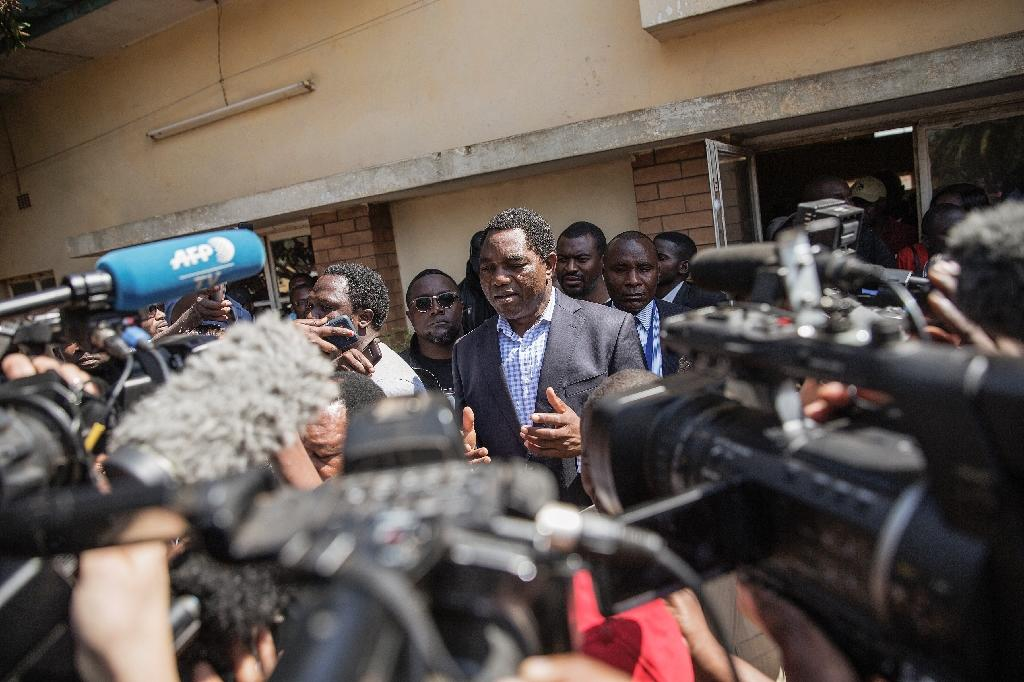 Zambian presidential candidate Hakainde Hichilema of main opposition party United Party for National Development, talks to journalists after casting his ballot during the Zambian general elections on August 11, 2016 in Lusaka (AFP Photo/Gianluigi Guercia)