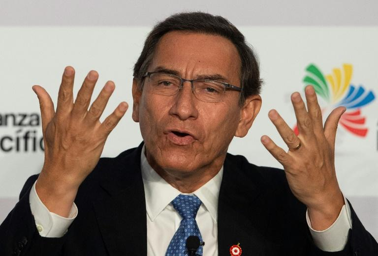 Vizcarra gestures during a speech to the Pacific Alliance Summit in Lima in 2019