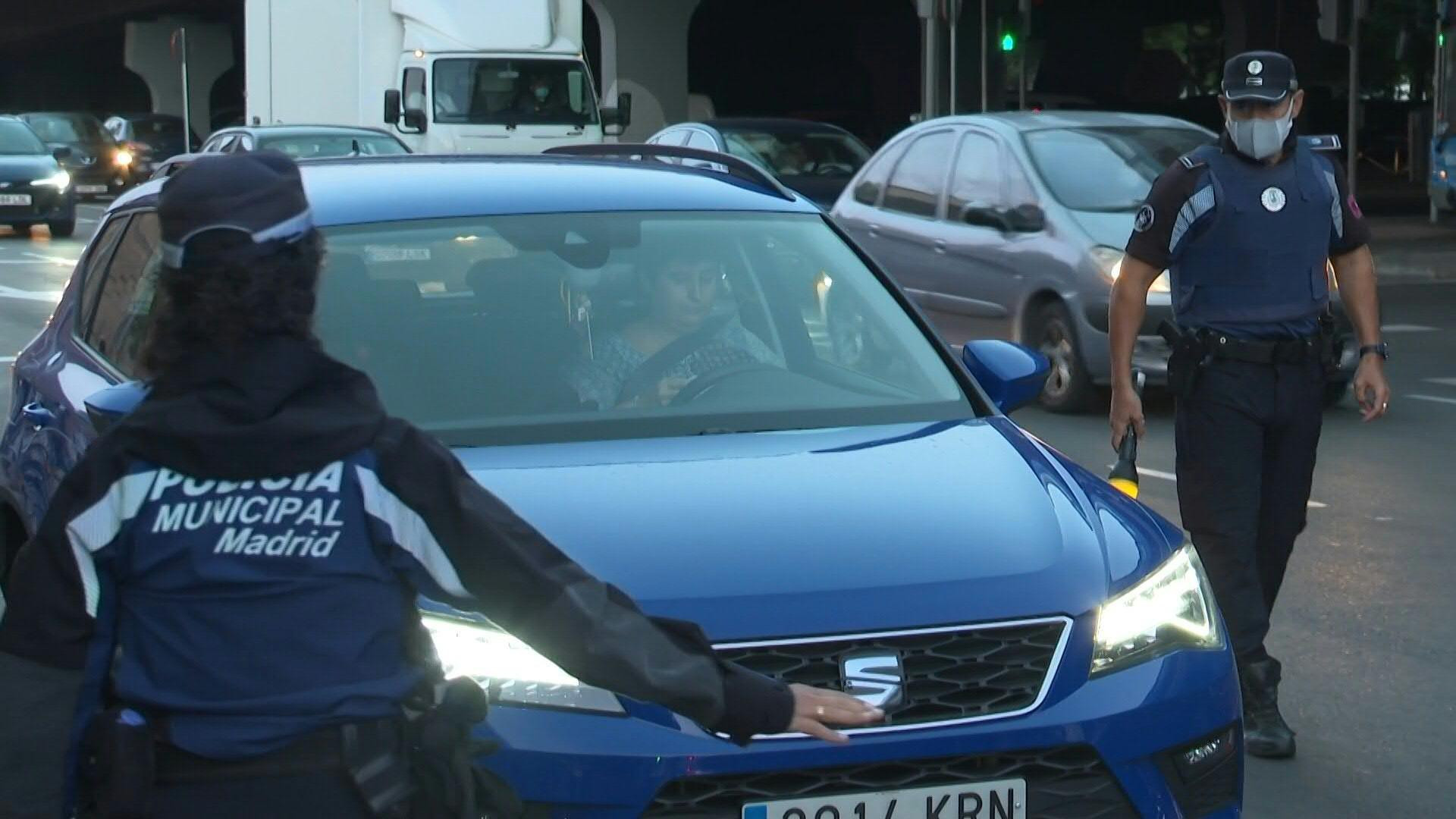Police officers control cars as Madrid begins partial virus lockdown [Video]
