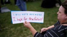 Columbine students register voters ahead of anti-gun walkouts