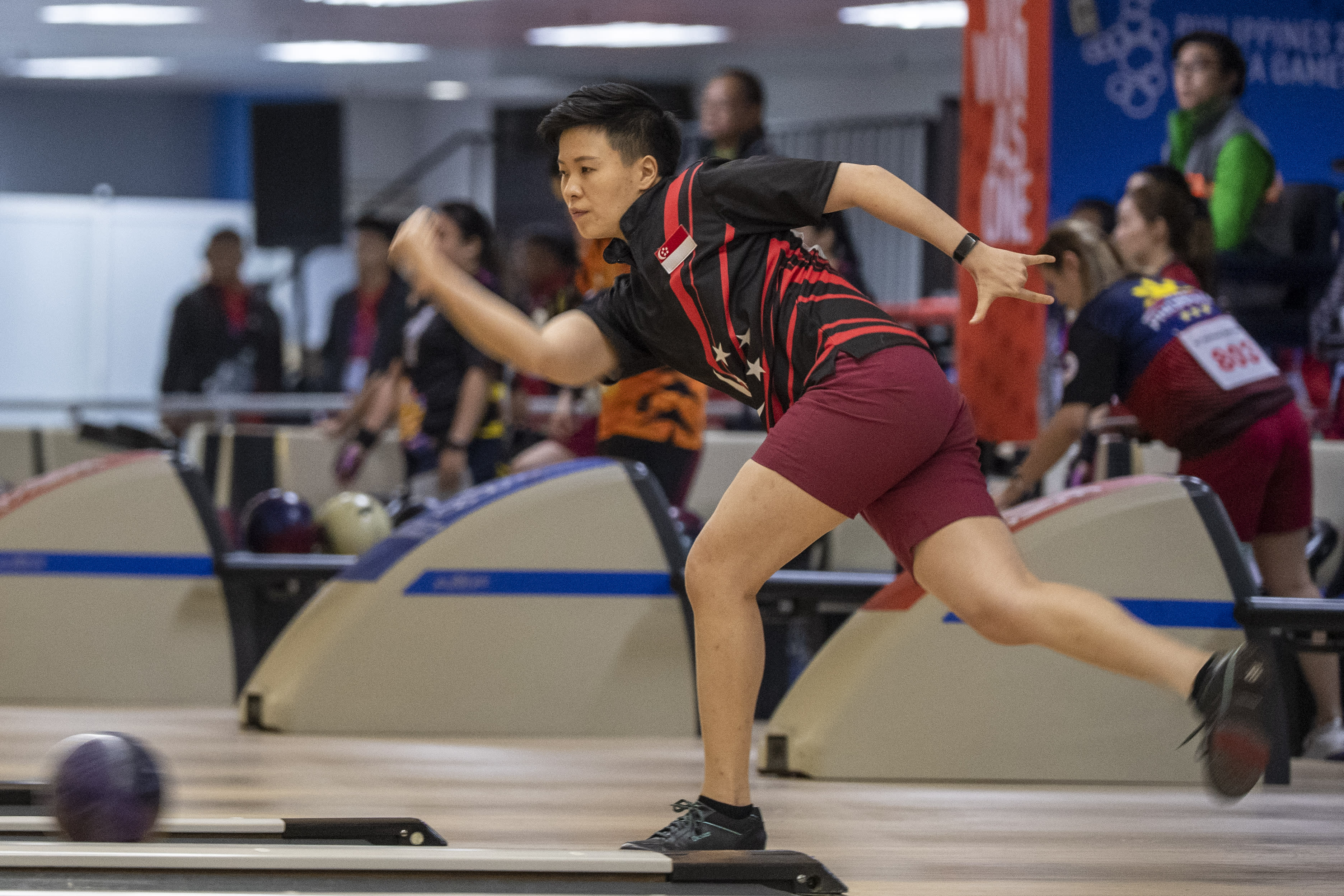 New Hui Fen earns bowling gold as typhoon causes postponements