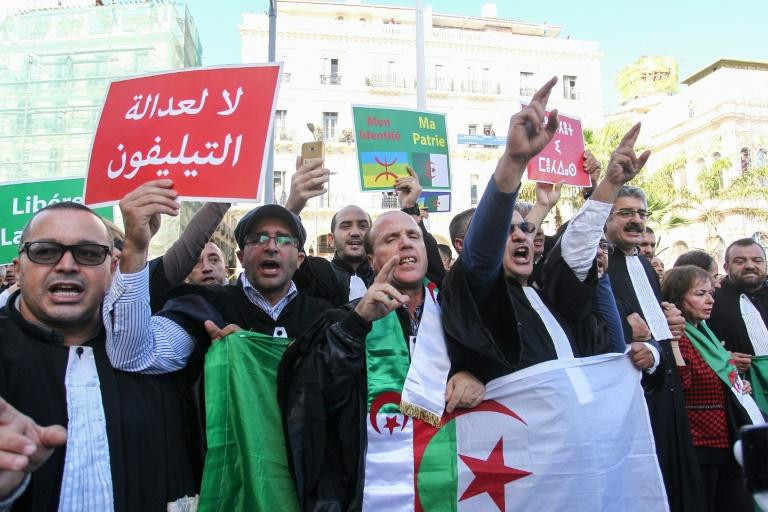 Lawyers take part in a demonstration demanding the independence of the judiciary system in Algiers on October 24, 2019