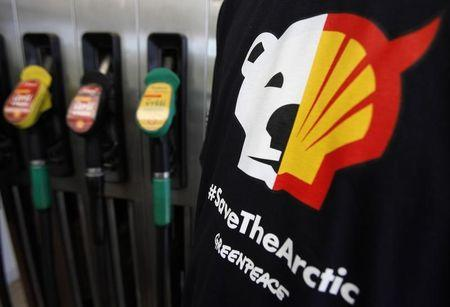 A T-shirt of a Greenpeace environmental activist is seen next to gas pumps at a Shell gas station in Prague