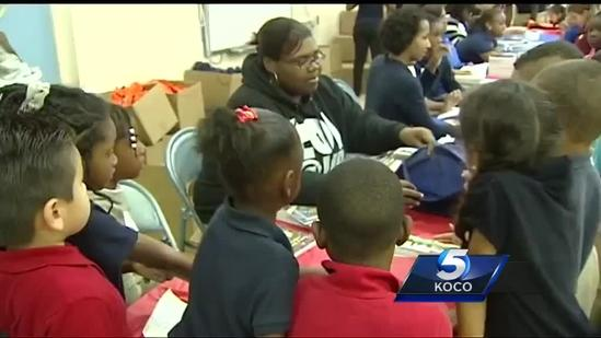 Kids pitch in to give books to Moore students
