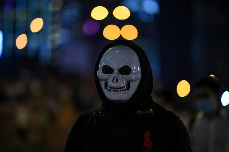 Hong Kong's pro-democracy protesters often wear masks on the streets, while a secretive website is seeking to reveal private details of leading activists and journalists (AFP Photo/Mohd RASFAN)