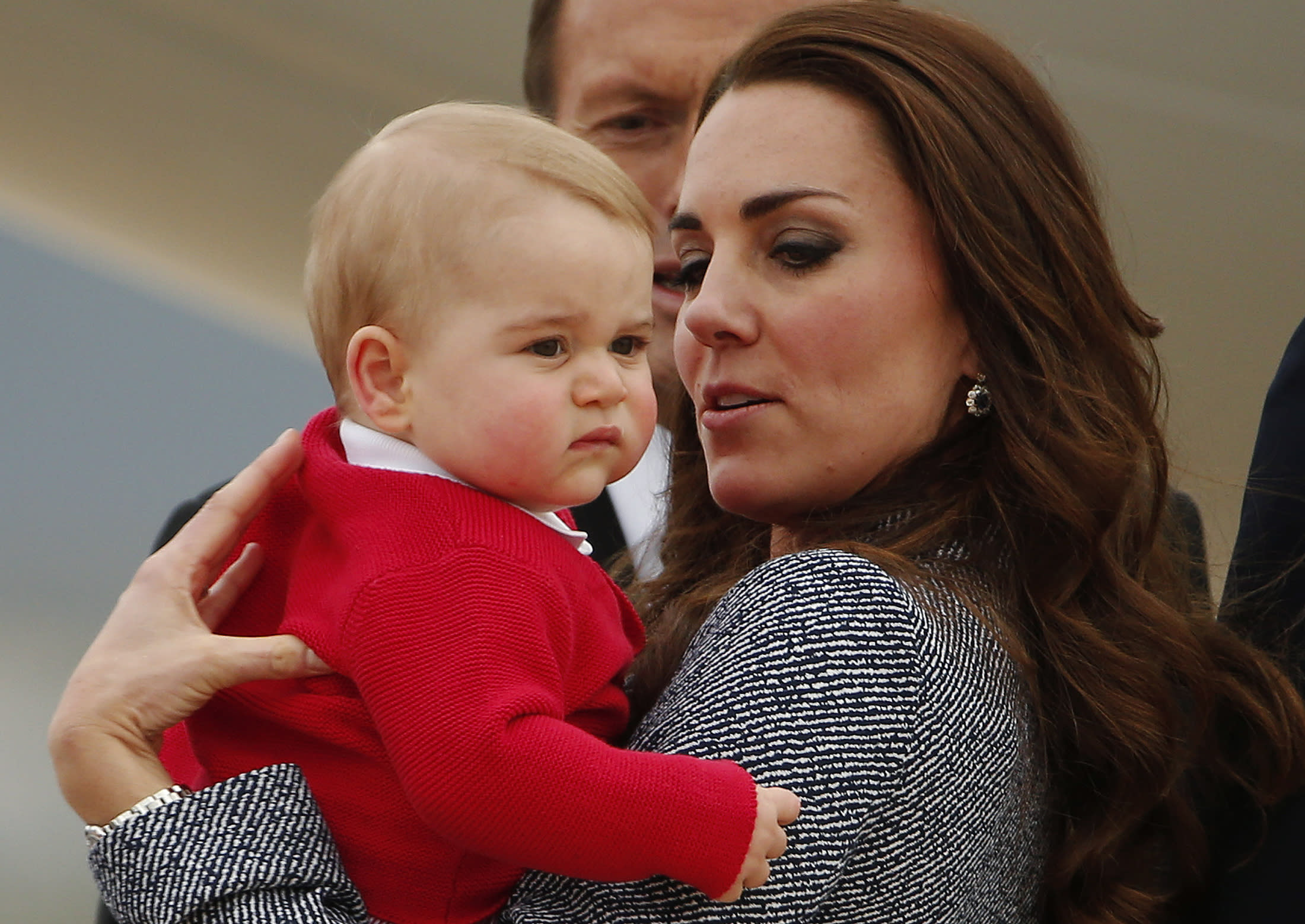 Britain's Catherine, the Duchess of Cambridge, holds her son Prince George as they prepare to board a plane with her husband Prince William (not pictured) to depart Canberra April 25, 2014. The Prince and his wife Kate are undertaking a 19-day official visit to New Zealand and Australia with their son Prince George. REUTERS/Phil Noble (AUSTRALIA - Tags: ROYALS ENTERTAINMENT POLITICS TPX IMAGES OF THE DAY)