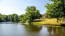 This 16th-century property lies within 63 acres of rolling Surrey countryside
