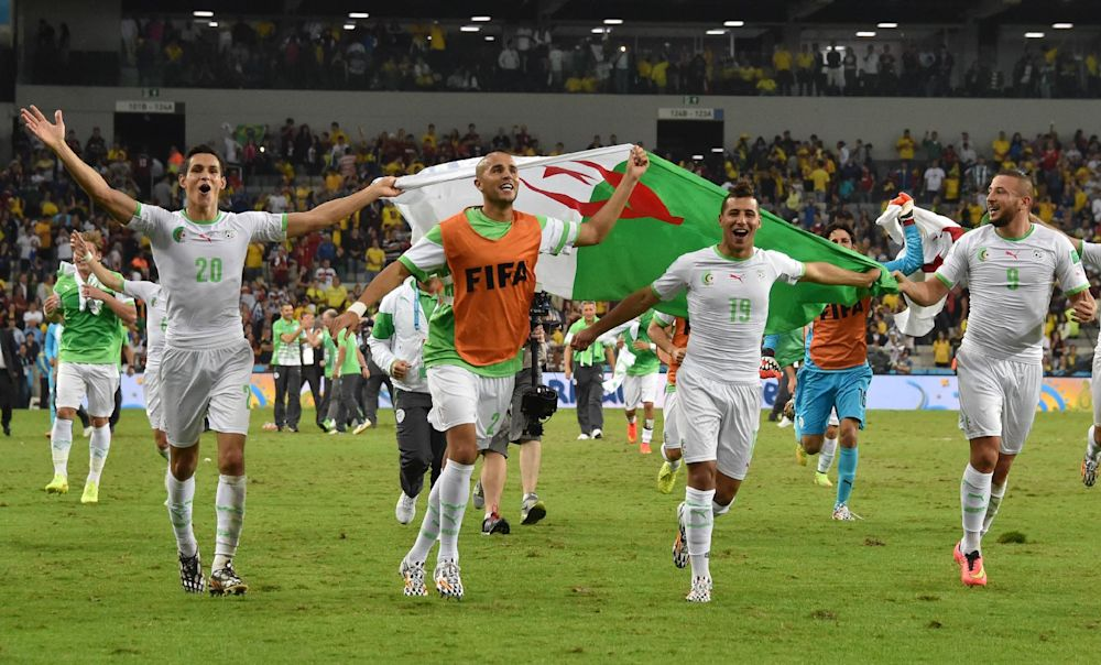 (L-R) Algeria players Aissa Mandi, Madjid Bougherra, Saphir Taider and Nabil Ghilas celebrate at the end of their World Cup match against Russia in Curitiba on June 26, 2014