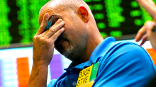Stocks fall, oil plummets 7%