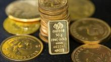 Gold hits 1-week high on dollar, political uncertainty