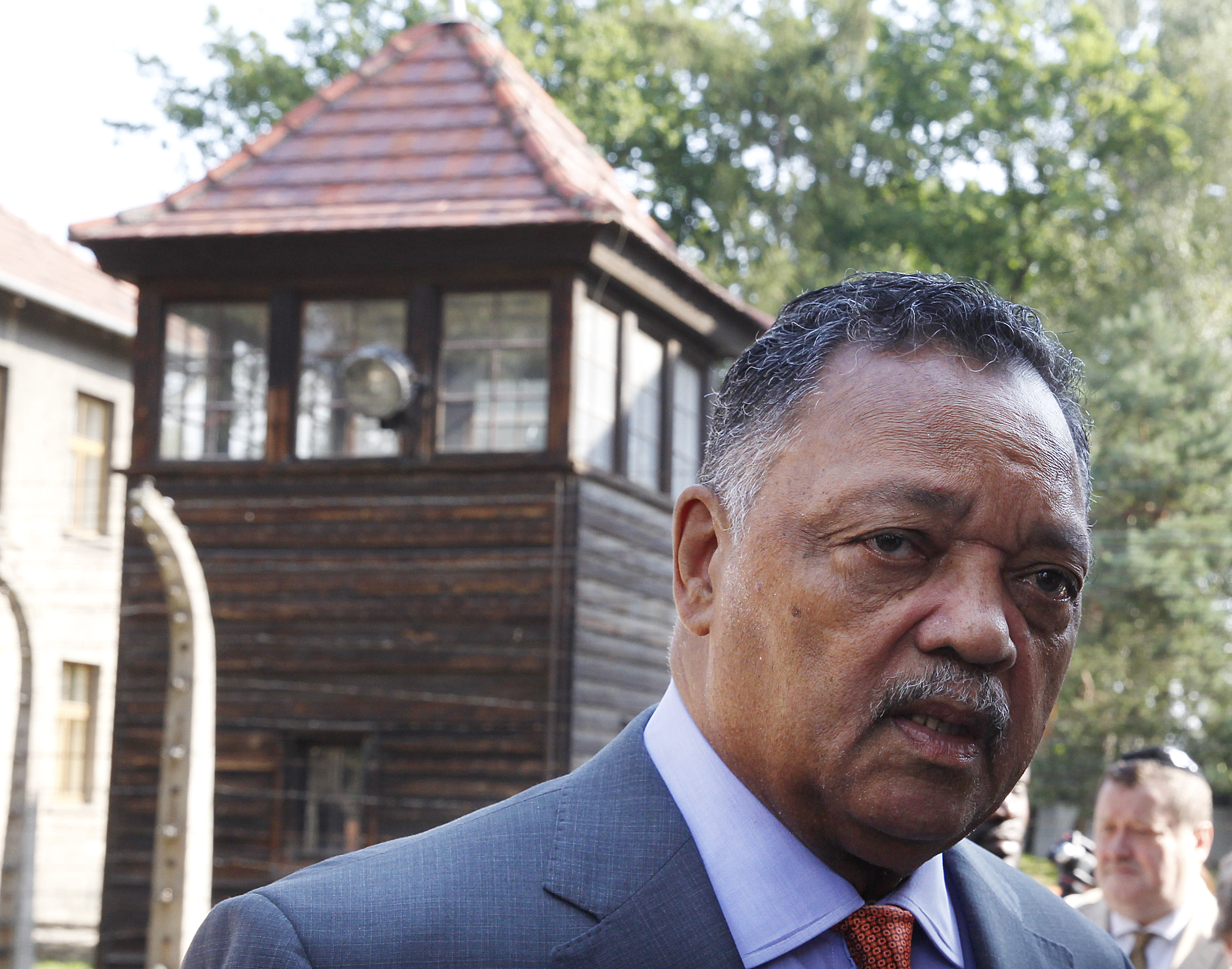The American civil rights activist Rev. Jesse Jackson visits the former Nazi death camp of Auschwitz-Birkenau in Oswiecim, Poland on Friday, Aug. 2, 2019. Rev. Jesse Jackson gathered Friday with survivors at the former Nazi death camp of Auschwitz-Birkenau to commemorate an often forgotten genocide — that of the Roma people. In addition to the 6 million Jews killed in camps such as Auschwitz, the Nazis killed other minorities during World War II, including between 250,000 and 500,000 Roma and Sinti. (AP Photo/Czarek Sokolowski)