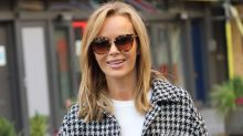 Amanda Holden spreads Christmas cheer by 'cleaning windows' in Mrs Claus outfit