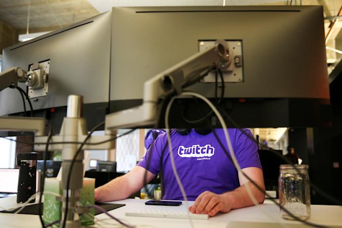 A man works at a computer at the offices of Twitch Interactive Inc, a social video platform and gaming community owned by Amazon, in San Francisco, California, U.S., March 6, 2017.  REUTERS/Elijah Nouvelage