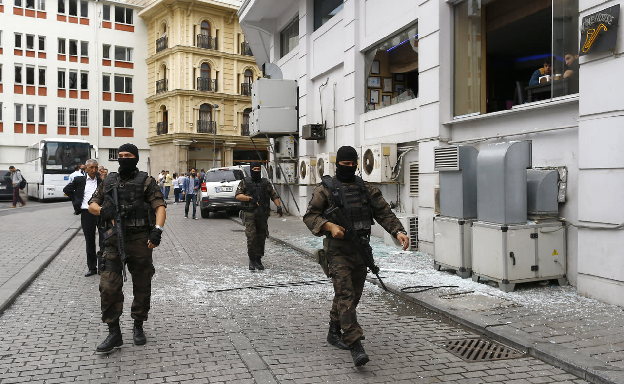 <p>Special police walks near the site where a Turkish police bus was targeted in a bomb attack in a central Istanbul district, Turkey, June 7, 2016. REUTERS/Osman Orsal – RTSGBX6 </p>