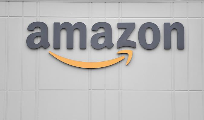 The logo of US online retail giant Amazon is seen at the distribution center in Staten Island as workers strike in demand that the facility be shut down and cleaned after one staffer tested positive for the coronavirus on March 30, 2020 in New York. - Amazon employees at a New York City warehouse walk off the job March 30, 2020, as a growing number of delivery and warehouse workers demand better pay and protections in the midst of the COVID-19 pandemic. (Photo by Angela Weiss / AFP) (Photo by ANGELA WEISS/AFP via Getty Images)