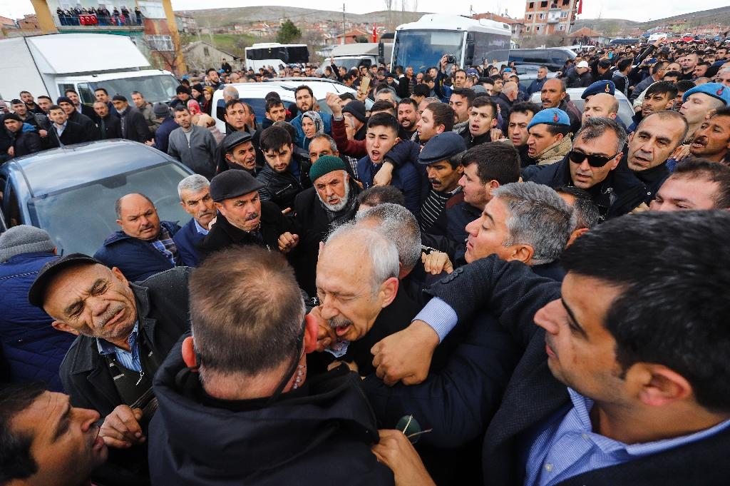 Kilicdaroglu (C) was mobbed at the funeral of a soldier in the capital Ankara (AFP Photo/Harun OZALP)