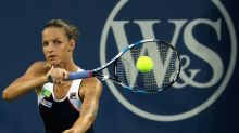 Pliskova wins twice in one day to reach semis, secure No. 1 spot