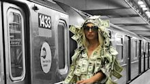 Playboy model rides the subway covered in money to give back