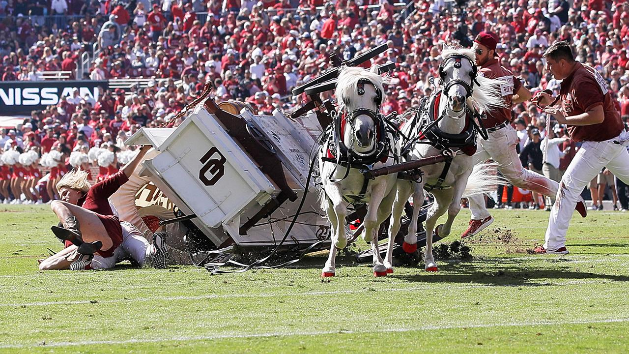 Chaos at college football game as half-time celebration goes awry