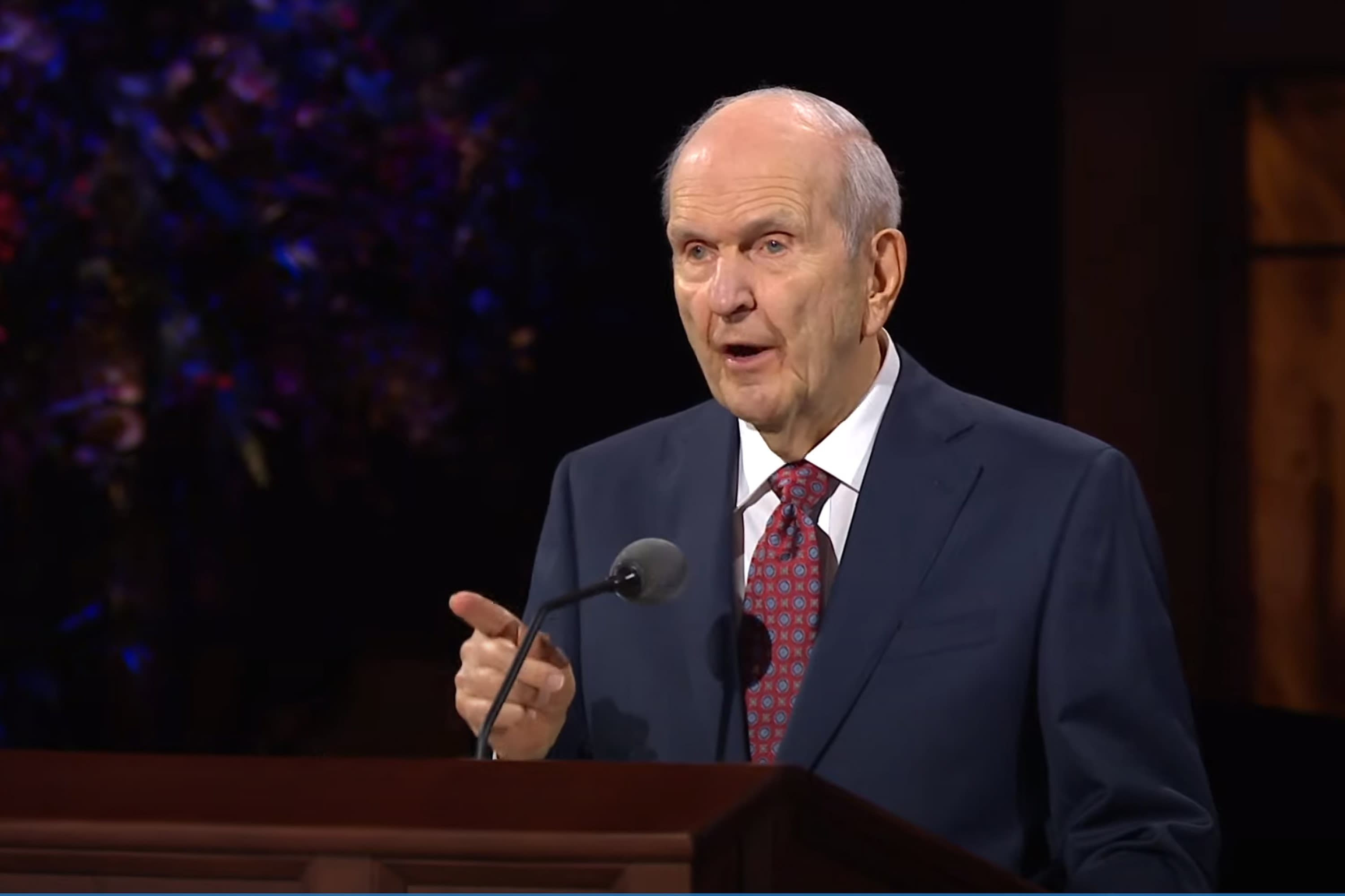In this Saturday, Oct. 3, 2020, video image streamed by The Salt Lake Temple of The Church of Jesus Christ of Latter-day Saints, church President Russell M. Nelson speaks during the opening of the 190th Semiannual General Conference at the Conference Center Theater on Temple Square in Salt Lake City. The twice-annual conference kicked off Saturday without anyone attending in person and top leaders sitting some 6-feet apart inside an empty room as the faith takes precautions to avoid the spread of the coronavirus. A livestream of the conference showed a few of the faith's top leaders sitting alone inside a small auditorium in Salt Lake City, Normally, top leaders sit side-by-side on stage with the religion's well-known choir behind them and some 20,000 people watching. (The Church of Jesus Christ of Latter-day Saints via AP)