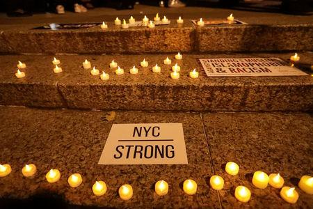 Candles are seen during a vigil for victims of the pickup truck attack at Foley Square in New York City, U.S., November 1, 2017. REUTERS/Jeenah Moon