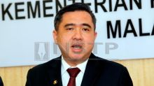 Irate cabbies want Anthony Loke to step down, not Dr M