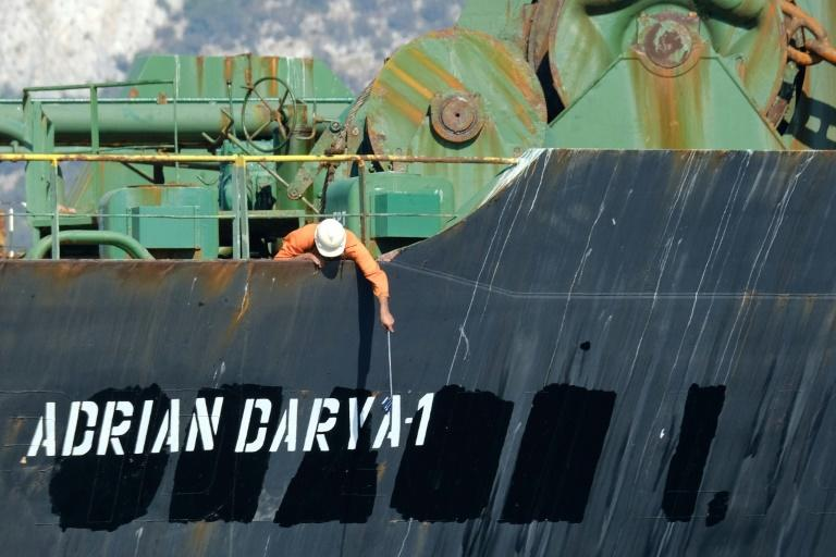 A crew member checks the new name of Iranian oil tanker Adrian Darya off Gibraltar in August 2019 before it headed, according to Britain, to Syria in defiance of assurances