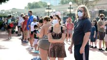 Disney World reopens as US virus death toll surges