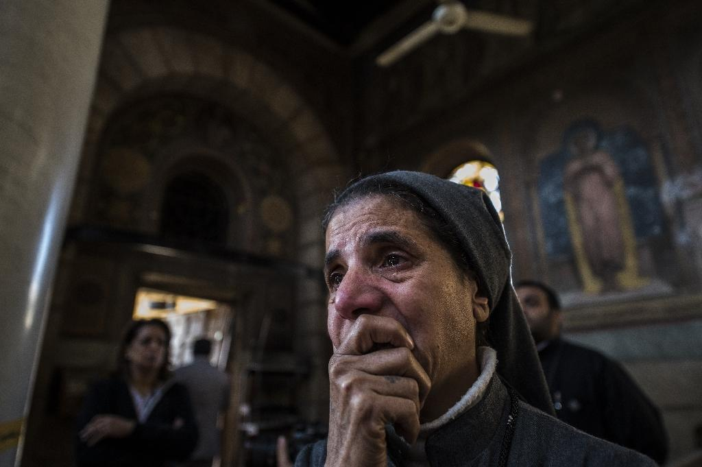 A nun is pictured after a bomb explosion at the Saint Peter and Saint Paul Coptic Orthodox Church in Cairo on December 11, 2016 (AFP Photo/KHALED DESOUKI)
