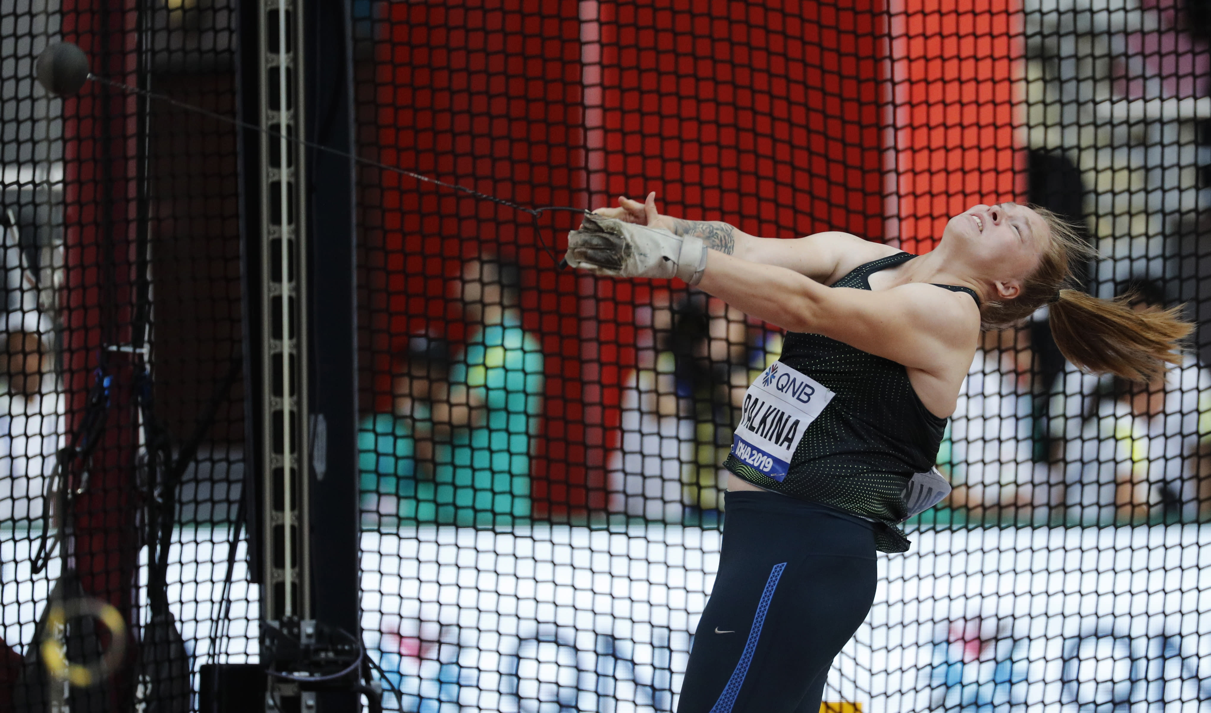 Sofiya Palkina, competing as a neutral athlete, competes during the women's hammer throw qualifying round at the World Athletics Championships in Doha, Qatar, Friday, Sept. 27, 2019. (AP Photo/Hassan Ammar)